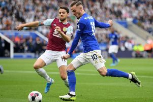 Burnley's Robbie Brady closes down Leicester City midfielder James Maddison