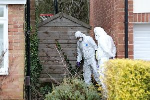 Police and forensic officers continue to investigate - SWNS