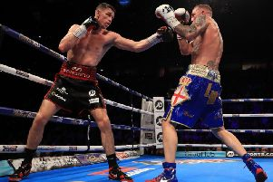 Callum Smith (L) of Liverpool in action against Luke Blackledge during their British Super-Middleweight Championship fight at Manchester Arena
