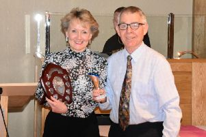 Christine McCarthy receives the Cyril Jones Athlete of the Year Award from Cyril Jones.