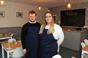 Leo Hill, the owner of Arthur's and the restaurant manager, Amelia Hawkins.