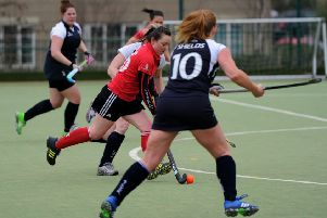 Pendle Forest Hockey Club (red) v Lytham Hockey Club at Marsden Heights Community School, Nelson. Lisa Crewe in action. Picture by Paul Heyes, Saturday March 12, 2016.
