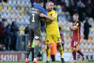 Fleetwood Town's Paddy Madden embraces Bradford City's Richard O'Donnell