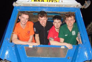From left, James Booth, Matt Woodhouse, Alfie Riley, and John Armitage  are driving a tractor to Cleethorpes to raise money for the Air Ambulance.