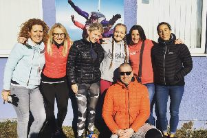 The six women who completed their tandem skydives, pictured with their instructor.