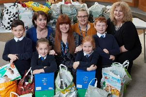 lending a hend: Pupils from Hendal Primary filled up 20 bags of food for St Catherine's.