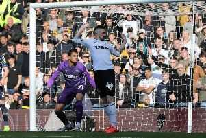 Derby County goalkeeper Kelle Roos and his team-mate defender Scott Malone watch on as the ball goes wide of the goal.