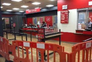 Staff getting ready at the new Post Office branch which has now opened inside the WHSmiths shop at the Victoria Shopping Centre.