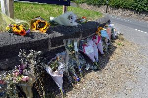 Floral tributes have been left at the scene.
