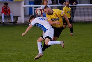 Action from Belper (in yellow) against Basford on Tuesday. Photo by Tim Harrison.