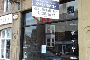 Moving to a new location - The sign on the window at 1 Station Parade in Harrogate.