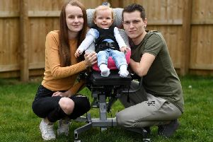 Imogen Holmes pictured with her parents Briony Winstanley and Stephen Holmes.