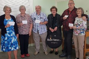 Prize winners at the Quay Scrabble Club charity event.
