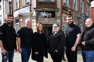 Owners Scott and Rebecca Bibby (second and third from left) are excited to open their fourth vape store in Poulton.