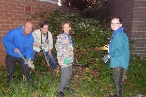 Some of the 53rd Blackpool Scouts clearing St Wilfreds Church garden