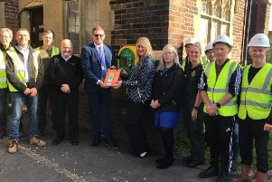 The F Parkinson team with the defibrillator at Careleton Crematorium