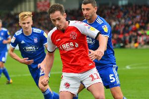 Fleetwood Town's Josh Morris vies for possession with Ipswich Town's James Wilson