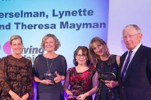 Theresa, centre, with Sophie, Countess of Wessex, presenter Nick Hewer and fellow award winners