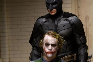 Christian Bale as Batman and the late Heath Ledger as The Joker in the classic movie, The Dark Knight