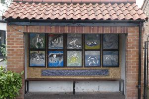 The first exhibition at the bus shelter, by Tinkos, focuses on global warming concerns.