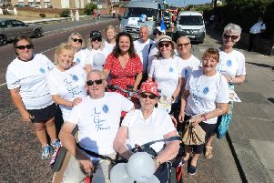 Just Good Friends founder Bev Sykes (middle row, left) and members of the companionship group taking part in St Annes Carnival procession