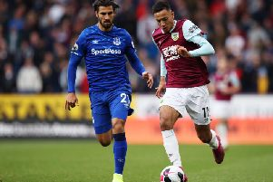 Burnley's Dwight McNeil takes on Everton's Andre Gomes