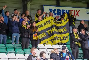 Harrogate Town supporters cheer on their team at Yeovil Towns Huish Park. Picture: Matt Kirkham