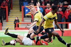 Rough and tumble action during Gainsborough Trinity's 2-2 draw at FC United of Manchester on Saturday. (PHOTO BY: John Rudkin)