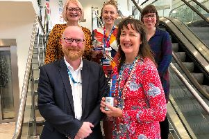 Members of the digital team with their award