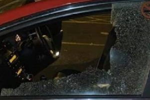 A damaged taxi window (Image: Blackpool Police)