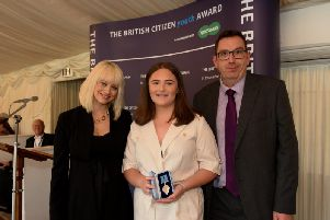 Ellie Toth is presented with her British Citizen Youth  Award, with celebrity guest host Kimberley Wyatt (left)