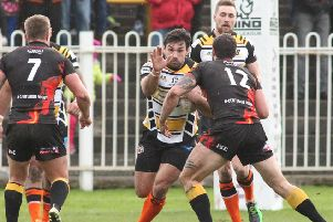 Matt Cook and James Clare in action for Castleford Tigers in their last meeting with Bradford Bulls.