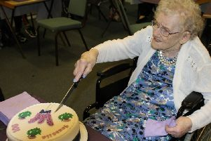 Isabella Townsend tucks into her cake