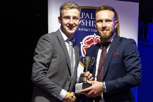 Joshua Sackfield (left) receives his award from Danny Lamb of Lancashire CCC Picture: ALF MYERS