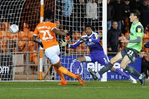 Armand Gnanduillet scores his and Blackpool's second against AFC Wimbledon