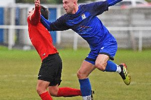 Jack Iley in airborne action for Squires Gate against Rylands   Picture: ALBERT COOPER