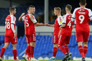 Fleetwood players congratulate Paul Coutts on scoring their second goal at Everton