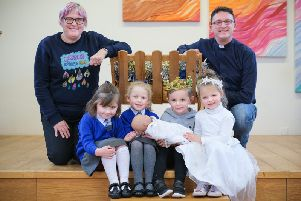 Rev Paul Critchley with church lay worker Ruth Dowson and local school children are encouraging the community to come together for the Guinness World Records title attemp