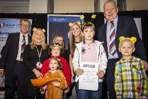 Guests and youngsters at the Wooden Spoon charity lunch. Fylde resident, and chairman of World Rugby, Bill Beaumont, is pictured second from right Picture: Rachel Lambert (Rachel Emma Creatives)