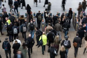 Rail passengers make their way through Manchester Victoria train station (OLI SCARFF/AFP via Getty Images)