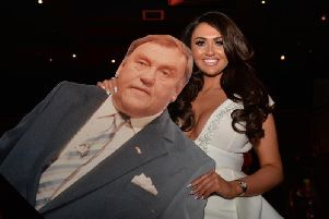 Charlotte Dawson with a cardboard cut out of her comedy legend dad Les at the launch of fashion range Fredafunk in Manchester last year (Picture: Dave Nelson)