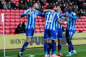 Kaikai, right, celebrates Matty Virtue's early goal prior to being brought off at half time