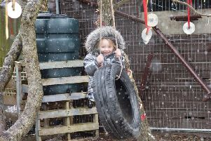 A youngster is full of smiles as she plays outdoors at the Little Explorers nursery, which became the first dedicated forestry school on the Fylde coast when it opened in 2016. It now plans to open its third branch in Poulton (Picture: Emma Rathbone/Little Explorers)
