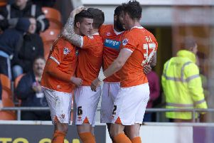 Gary Madine (left) celebrates a Championship goal for Blackpool against Leeds United in 2015