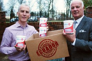 Keith Allum, left, of ArthoVite prepares to send his first export order of Collagen Plus to Ecuador, assisted by Les Ellaby-Blunt of the North and Western Lancashire Chamber of Commerce
