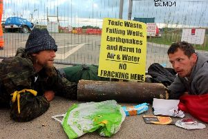 Knox shackled to another man during fracking demonstration CREDIT: DWP