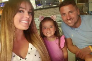 David Cram, better known as Kenny, with wife Keeley and their daughter Robyn