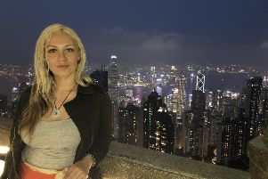Shell Buchanan, 31, says she has been forced to stay indoors and cannot leave the Chinese city she was visiting due to the Coronavirus outbreak