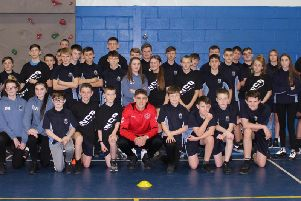 Midfielder with some of the pupils at Fleetwood High School