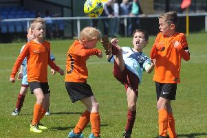 Under-7 Hogan Cup final action between Lytham and YMCA